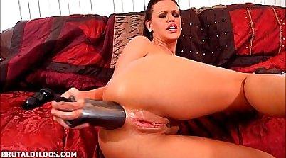 Hot brunette brutally tugs pussy