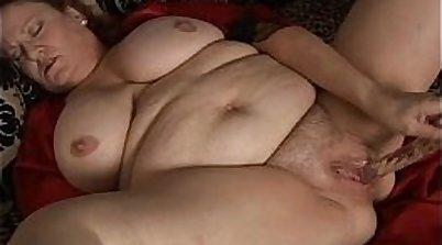 Fat mature fucks his quivering pussy