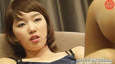 Chinese femdom masterbating with her rod